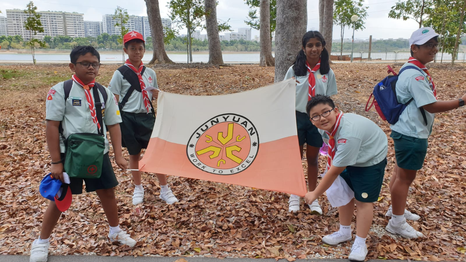 Scout Group photo with school flag.jpg