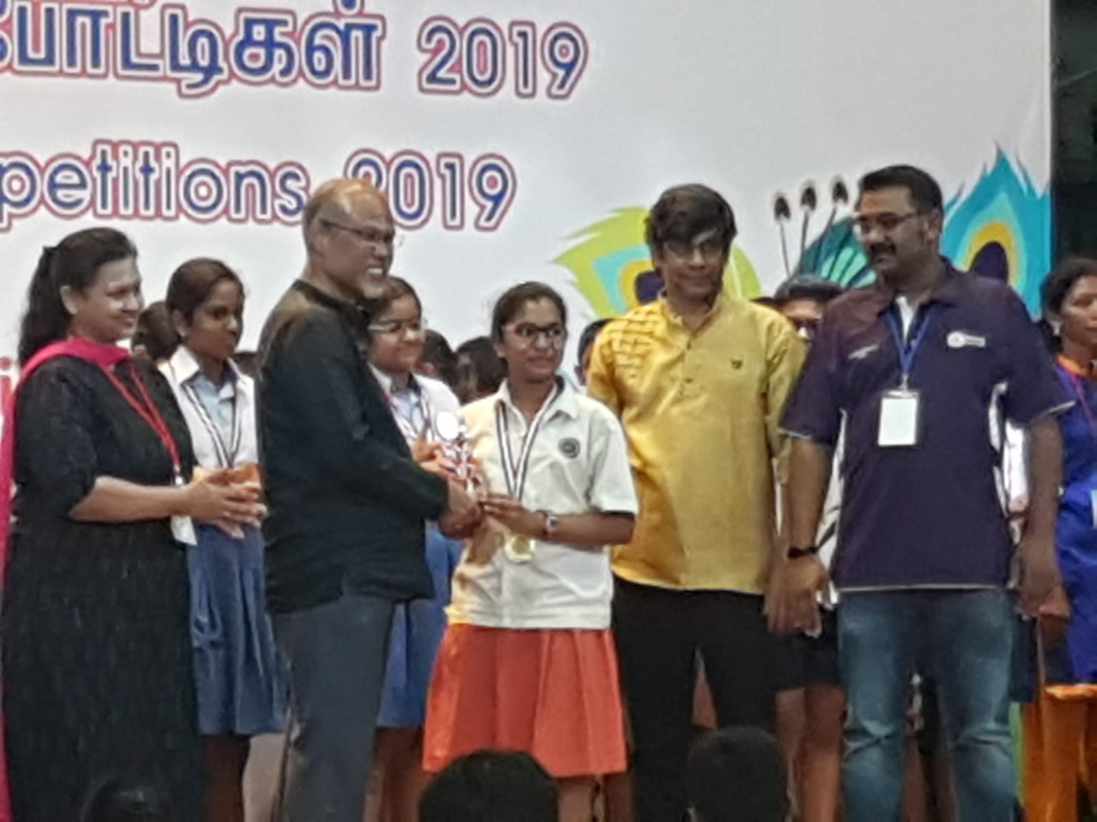 Priya receiving medal from Mr Masagos.JPG
